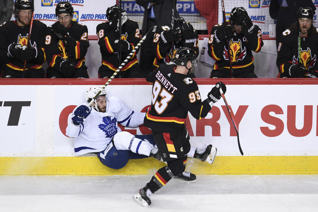 Florida Panthers acquire Sam Bennett, 6th-round pick from Calgary Flames for Emil Heineman, 2nd-round pick