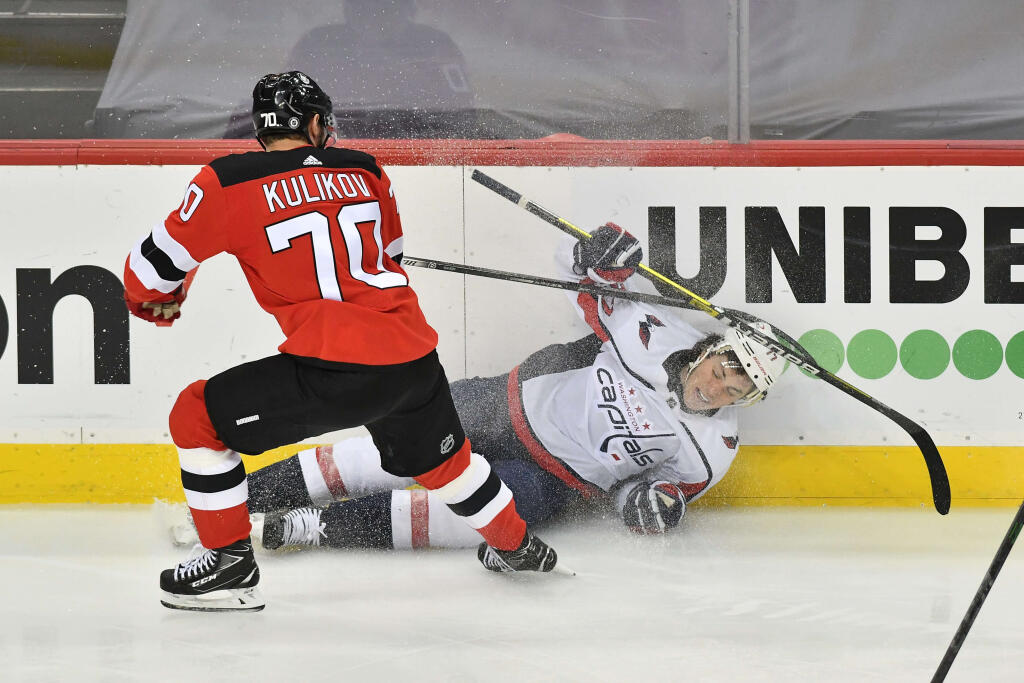 Edmonton Oilers acquire defenceman Dmitry Kulikov from New Jersey Devils for a 4th-round pick